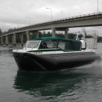 Explorer 2 2 TDi hovercraft passing under the Harstine Island bridge, Puget Sound Washington.