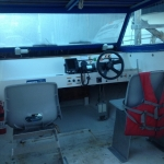 Hovercraft Explorer 22 for sale. Front interior photo, front seats, and helm shown.