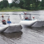 Hovercraft Sevtec Two Vanguard's, 14x7, 1994 side by side on the Skycomish River Near Monroe Washington.