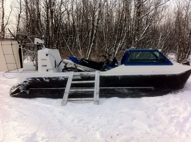 Hovercraft Explorer 22 for sale. VW Turbo Diesel engine, shown loaded with a snowmobile.