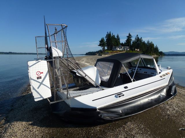 Hovercraft Amphibious Marine Vanguard14 40hp parked on sand bar near Boston Harbor Washington.