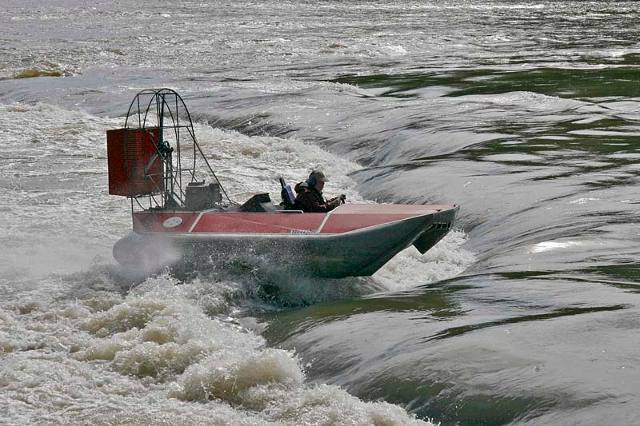 Sevtec Vanguard 14 hovercraft in rapids.