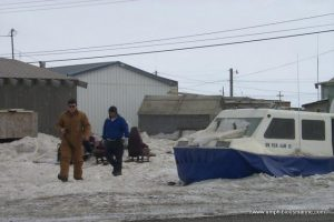 John Carter and Bryan Phillips with client in Barrow Alaska for hovercraft consulting.